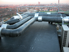 Recently AMC Roofing designed and constructed this new roof over the two ducting risers to the roof of Hammersmith Hospital, in the process overcoming many awkward pipe and cable details penetrating up through the riser.